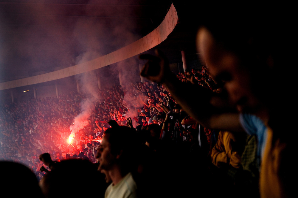 Fans of Football Club Red Star celebrate in the stands following a goal against city and league rival FC Partizan in Red Star Stadium, Belgrade, Serbia.