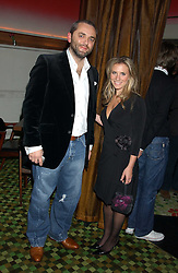 KARL FOWLER and TV sports presenter GEORGIE THOMPSON at a launch party for Kraken Opus's new luxury sports books held at Sketch, 9 Conduit Street, London W1 on 22nd February 2006.<br />