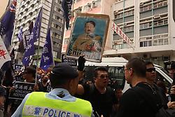 October 1, 2018 - Hong Kong, CHINA - Pro-Hong Kong independence supporter display an image of Chinese chairman, Xi Jin-ping as an Adolf Hitler during annual anti-China rally on the national day. Oct-1,2018 Hong Kong.ZUMA/Liau Chung-ren (Credit Image: © Liau Chung-ren/ZUMA Wire)