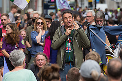 Comedian and journalist Mark Thomas addresses environmental activists from Extinction Rebellion blocking roads in the Covent Garden area during the first day of Impossible Rebellion protests on 23rd August 2021 in London, United Kingdom. Extinction Rebellion are calling on the UK government to cease all new fossil fuel investment with immediate effect. (photo by Mark Kerrison/In Pictures via Getty Images)
