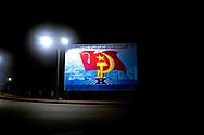 Propaganda billboard at night in a street of Hue, Vietnam, Southeast Asia
