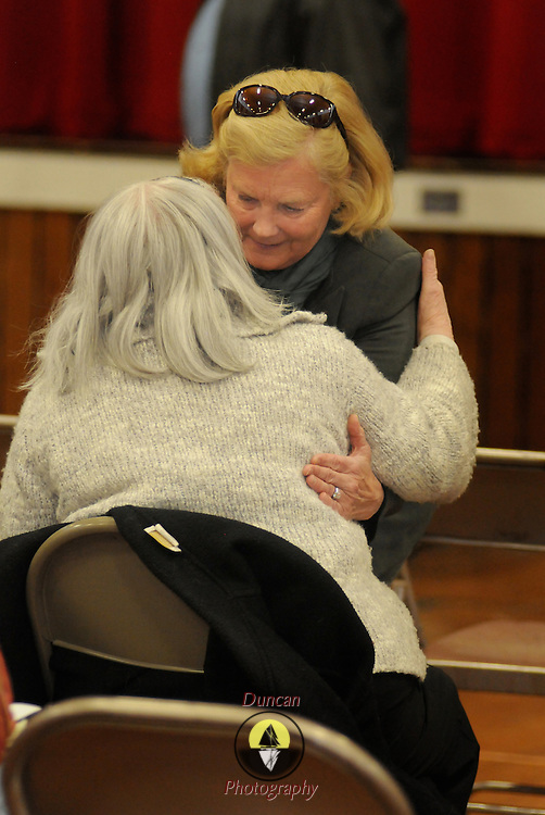 """2/26/12 -- BRUNSWICK, Maine. U.S. Congresswoman Chellie Pingree visits with a friend after speaking to the sparsely attended Democratic Caucus on Sunday afternoon at Brunswick Middle School. She said, """"I know that you are busy people.  But - you're here because you care. If you each can bring 10 people to the polls to reelect President Obama we will have a shot at slowing down the conservative agenda."""" She added that she didn't like the Republican alternatives to Obama and that local Democratic legislators needed support as well. Photo by Roger S. Duncan."""