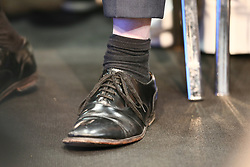 © Licensed to London News Pictures. 04/10/2021. Manchester, UK.  Prime Minister Boris Johnson's shoes look rather worn as he attends the Conservative Party Conference on Monday. The annual Conservative Party Conference has returned to Manchester this year after being held online in 2020. Photo credit: Adam Vaughan/LNP