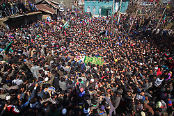 March 29, 2017 - Srinagar, Jammu and Kashmir, India - Kashmiri villagers carry the body of a militant, identified as Touseef Ahmad in Yaripora village of South Kashmir's Kulgam district in Indian Controlled Kashmir. A militant and three civilians were killed on Tuesday in an encounter and clashes in Chadoora area, police had said. (Credit Image: © Umer Asif/Pacific Press via ZUMA Wire)