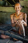 Mentawai indigenous old man with arrows.