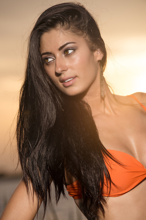 Portrait of young woman in bikini at sunset