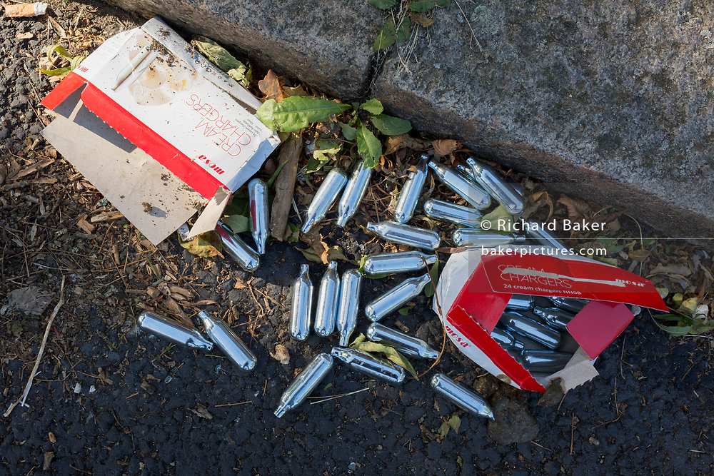 Nitrous oxide Mosa cream charger canisters lie in the gutter of a surburban south London street, on 2nd September 2019, in London, England. Nitrous oxide is illegal under the 2016 Psychoactive Substances Act but laughing gas is now the fourth most used drug in the UK, according to the Global Drug Survey 2015.