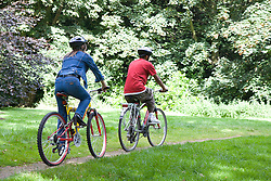 Woman and teenager out in the countryside cycling,