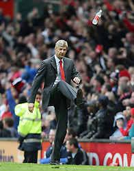 Arsenal's manager Arsene Wenger kicks a bottle in frustration