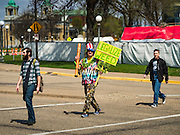 "20 APRIL 2016 - ST. PAUL, MN: A man who identified himself as ""Cool Breeze"" walks to a marijuana legalization rally in St. Paul. About 100 people gathered at the Minnesota State Capitol in St. Paul and marched through downtown St. Paul calling for the decriminalization of marijuana. April 20 (4/20) has become a sort of counter culture holiday in the US, with marches in many cities calling for the legalization of marijuana.      PHOTO BY JACK KURTZ"