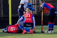 BILTHOVEN -  Hoofdklasse competitiewedstrijd dames, SCHC v hdm, seizoen 2020-2021.<br /> Foto: Ginella Zerbo (SCHC) gevloerd, Pien Dicke (SCHC) en Miloe Jaeger (SCHC) steunen haar