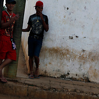 Central America, Cuba, Remedios. Teenage boys sneak a smoke on the street corner in Remedios. Note: Unsharp image.