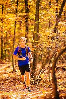 Man running and mountain biking in blue ridge mountains in fall color.