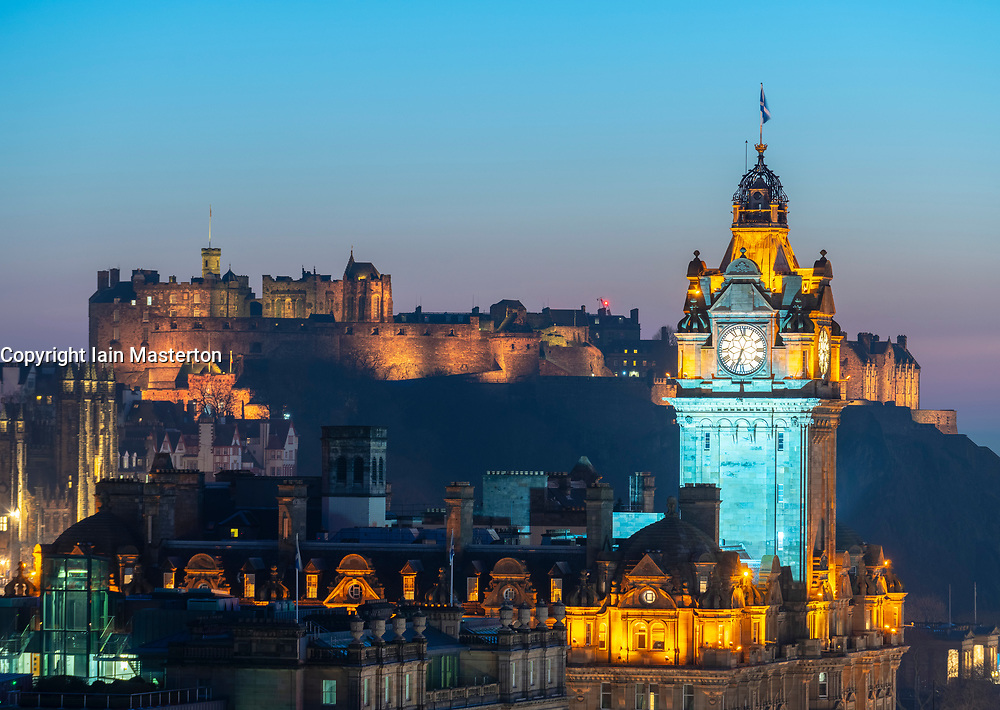 Edinburgh, Scotland, UK. 26 February, 2019. View at sunset over famous Edinburgh skyline toward the Balmoral Hotel clocktower and Edinburgh Castle  from Calton Hill in Edinburgh , Scotland, UK