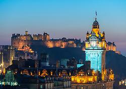 Edinburgh, Scotland, UK. 26 February, 2019. View at sunset over famous Edinburgh skyline toward the Balmoral Hotel clocktower and Edinburgh Castle  from Calton Hill in Edinburgh , Scotland, UK