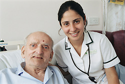 Female occupational therapist with elderly patient smiling,