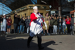 Windsor, UK. 5th March, 2019. Competitors in fancy dress on the theme of a '15th century housewife' from local businesses show off their flipping skills and fancy footwork as they take part in the 13th Windsor and Eton Flippin' Pancake Challenge on Shrove Tuesday in aid of Alexander Devine Children's Hospice Service and Windsor Homeless Project.