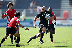 DJ Forbes attacks during the XIX Commonwealth Games 7s rugby match between New Zealand and Canada held at The Delhi University in New Delhi, India on the  10 October 2010..Photo by:  Ron Gaunt/photosport.co.nz