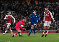 Football - 2017 / 2018 Carabao (EFL/League) Cup - Semi-Final, Second Leg: Arsenal (0) vs. Chelsea (0)<br /> <br /> David Ospina (Arsenal FC) gathers the ball ahead of Marcos Alonso (Chelsea FC)  at The Emirates.<br /> <br /> COLORSPORT/DANIEL BEARHAM