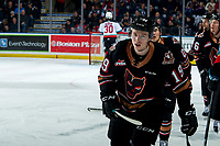 KELOWNA, BC - FEBRUARY 17: Carson Focht #19 of the Calgary Hitmen skates to the bench to celebrate a third period goal against the Kelowna Rockets at Prospera Place on February 17, 2020 in Kelowna, Canada. (Photo by Marissa Baecker/Shoot the Breeze)