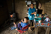 Esthela, the wife of Pima rancher José Angel Galaviz prepares tortillas while her sons wait at their home in the Sierra Mountains near Maycoba, in the Mexican state of Sonora.  (Jose Angel Galaviz Carrillo is featured in the book What I Eat: Around the World in 80 Diets.)