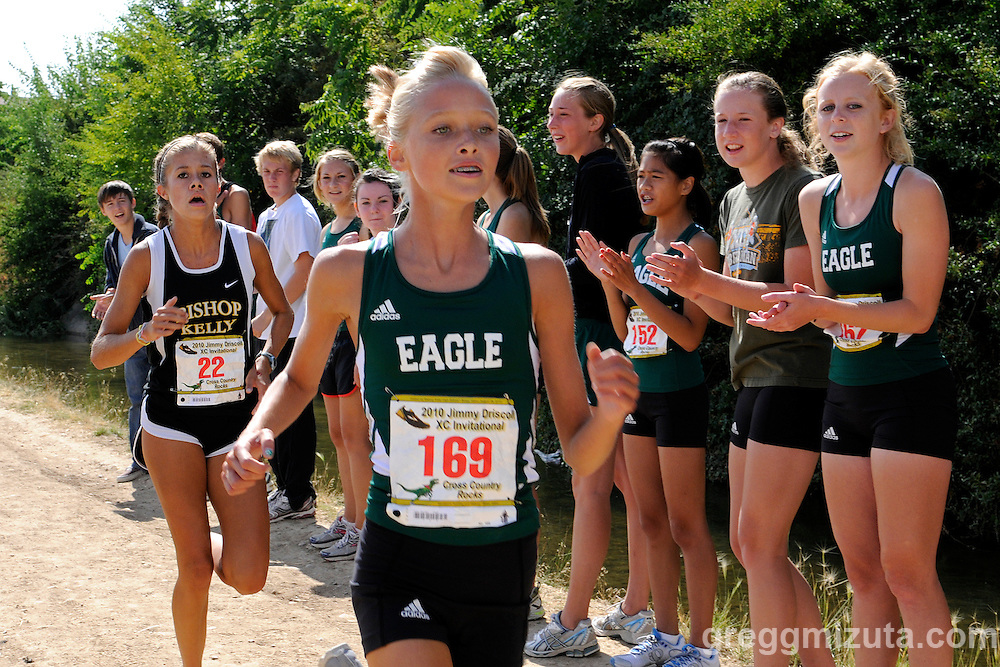 Eagle freshman Rachael Tatko and Bishop Kelly junior Emily Nist have separated from the lead pack two miles into the girl's varsity race during the Jimmy Driscoll Invitational at Bishop Kelly High School on August 28, 2010.<br /> <br /> Tatko won the race (19:03.47) followed by Bishop Kelly's Rebecca Lassere (19:22.21) and Nist (19:30.02).