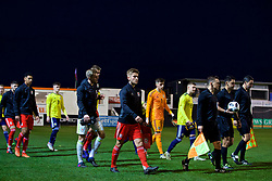 RHYL, WALES - Wednesday, November 14, 2018: Wales' captain Ryan Reynolds leads the team out before the UEFA Under-19 Championship 2019 Qualifying Group 4 match between Wales and Scotland at Belle Vue. (Pic by Paul Greenwood/Propaganda)