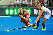 England's Susannah Townsend passes while under pressure from Xan de Waard of The Netherlands. England v The Netherlands - Final Unibet EuroHockey Championships, Lee Valley Hockey & Tennis Centre, London, UK on 30 August 2015. Photo: Simon Parker