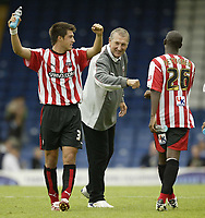 Photo: Aidan Ellis.<br /> Bury FC v Brentford. Coca Cola League 2. 01/09/2007.<br /> Brentford manager Terry Butcher enjoys victory with Grant Basey and Adrian Pettigrew