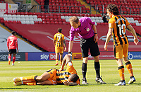 Hull City's Josh Magennis is grounded following a first half challenge<br /> <br /> Photographer Rich Linley/CameraSport<br /> <br /> The EFL Sky Bet League One - Lincoln City v Hull City - Saturday 24th April 2021 - LNER Stadium - Lincoln<br /> <br /> World Copyright © 2021 CameraSport. All rights reserved. 43 Linden Ave. Countesthorpe. Leicester. England. LE8 5PG - Tel: +44 (0) 116 277 4147 - admin@camerasport.com - www.camerasport.com