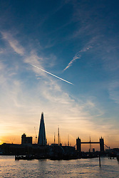 London, March 10th 2015. The sun sets over London after a warm early spring day. PICTURED: The Shard and Tower Bridge act as a backdrop to the Dutch sailing barges tied up at the residential Hermitage Moorings in Wapping.