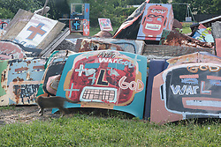 Painted car hoods.  Heidelberg Project, Detroit, Michigan.  The Heidelberg Project is a grass roots project started by artist Tyree Guyton that uses art to help revitalize the embattled neighborhood.  Each year, over 275,000 people visit the project .  For more information, go to www.heidelberg.org