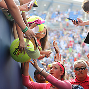 Victoria Azarenka, Belarus, signing autographs after her win against Alize Cornet, France, during the Women's Singles competition at the US Open. Flushing, New York, USA. 31st August 2013. Photo Tim Clayton