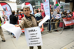 © Licensed to London News Pictures. 04/09/2018. London, UK. A Pro Jeremy Corbyn protestor hands out leaflets outside the Labour Party headquarters in London ahead of a National Executive Committee meeting. The Labour Party's ruling body is expected to vote on whether to adopt, in full, the IHRA (International Holocaust Remembrance Alliance) definition of anti-Semitism. Photo credit: Ben Cawthra/LNP