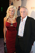 l to r: Holly Madison and Hugh Hefner at the Celebrity Catwalk co-sponsored by Alize held at The Highlands Club on August 28, 2008 in Los Angeles, California..Celebrity Catwork for Charity, a fashion show/lifestyle event, raises funds & awareness for National Animal Rescue.