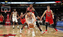 January 27, 2019 - Chicago, IL, USA - Cleveland Cavaliers guard Matthew Dellavedova (18) grabs a pass ahead of Chicago Bulls guard Kris Dunn (32) in the fourth quarter on Sunday, Jan. 27, 2019 at the United Center in Chicago, Ill. The Cavaliers defeated the Bulls, 104-101. (Credit Image: © Brian Cassella/Chicago Tribune/TNS via ZUMA Wire)