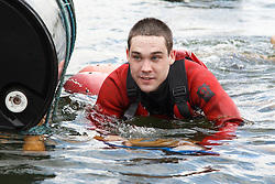 Visually impaired man in the water during rafting activity at the National Water Sports Centre.