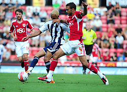 Bristol City's Liam Fontaine battles for the ball with West Bromwich Albion's Peter Odemwingie   - Photo mandatory by-line: Joseph Meredith / JMPUK - 30/07/2011 - SPORT - FOOTBALL - Championship - Bristol City v West Bromwich Albion - Ashton Gate Stadium, Bristol, England