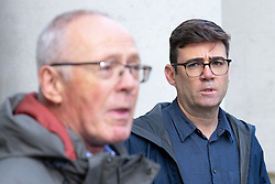 © Licensed to London News Pictures. 15/10/2020. Manchester, UK. Sir Richard Leese and Manchester Metro Mayor Andy Burnham at a press conference in front of Manchester Central Library in St Peter's Square , central Manchester , as negotiations continue regarding placing the city on a Tier 3 lockdown, closing pubs and limiting the ways in which households can mix, in order to reduce the spread of Coronavirus . Photo credit: Joel Goodman/LNP