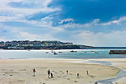 Women with children play on the strand in Kilkee bay popular beach resort, County Clare, West Coast of Ireland