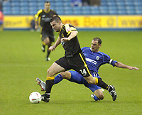 Photo: Alan Crowhurst. Millwall v Cardiff City, Coca-Cola Championship, 23/10/04. Alan Lee of Cardiff tries to escape the tackle of Kevin Muscat.