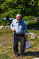 Borjomi , Georgia - August 13 2019 :  old farmer man posing smiling in the mountains  of Samtskhe Javakheti region