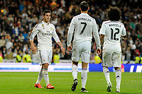 Real Madrid´s Cristiano Ronaldo, Marcelo Vieira and James Rodriguez celebrate a goal during 2014-15 La Liga match between Real Madrid and Malaga at Santiago Bernabeu stadium in Madrid, Spain. April 18, 2015. (ALTERPHOTOS/Luis Fernandez)