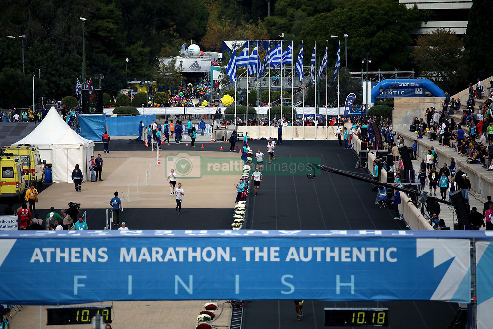 November 12, 2017 - Athens, Attica, Greece - Runners entering the Panathenaic stadium at the 35th Athens Classic Marathon in Athens, Greece, November 12, 2017. (Credit Image: © Giorgos Georgiou/NurPhoto via ZUMA Press)