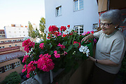 Vienna, Karl-Marx-Hof. Doris Nasty, 82, lives here since 1930 when construction was finished. She loves to take care of the flowers on her balcony.
