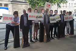 June 2, 2017 - London, England, United Kingdom - People with masks of Tim Farron (Lib-Dem leader), Nicola Sturgeon (Scottish First Minister) and photos of Labour Party's leader Jeremy Corbyn, are seen while demonstrate at Whiteall near Downing Street, London, on June 2, 2017. (Credit Image: © Alberto Pezzali/NurPhoto via ZUMA Press)