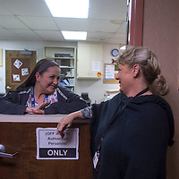 Executive Director of Behavior Health Services Erika Hayes, right, talks with Jessica McKinney at the Rehoboth McKinley Christian Hospital addiction rehabilitation center in Gallup Tuesday.