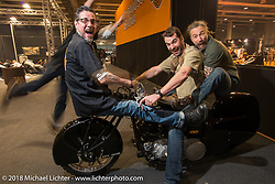 A happy road crew from W&W Cycles during teardown at Motor Bike Expo. Verona, Italy. January 24, 2016.  Photography ©2016 Michael Lichter.