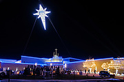 22 DECEMBER 2020 - WEST DES MOINES, IOWA: The Christmas Star suspended by a crane over the Lutheran Church of Hope during the drive through Christmas experience. About 3,000 cars per night going through the drive through Christmas pageant at Lutheran Church of Hope in West Des Moines. The church staged the drive through Christmas pageant because they decided it wasn't safe to hold in person Christmas services or pageant during the COVID-19 pandemic. On Tuesday night people started lining up to get into the pageant almost an hour before it started.      PHOTO BY JACK KURTZ