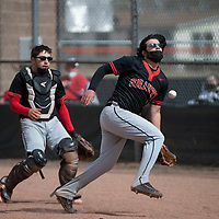 Grants Pirates pitcher William Archuleta and catcher Andres Lopez attempt to catch a foul ball behind home plate during their varsity baseball game against the Gallup Bengals Tuesday afternoon in Gallup.
